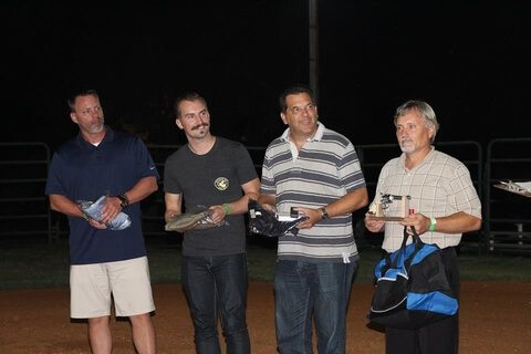 Guests receiving awards for six gun fast draw at Corporate Event