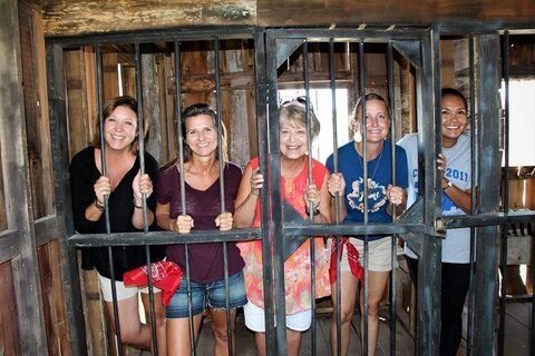 Guests snapping photos in the Old West Jail